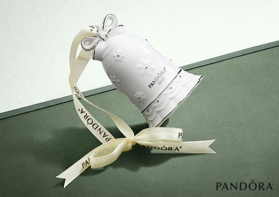 f1c0afc13 The PANDORA Jingle Bell Holiday Ornament is FREE with a £99 spend on PANDORA  at the PANDORA UK eStore.