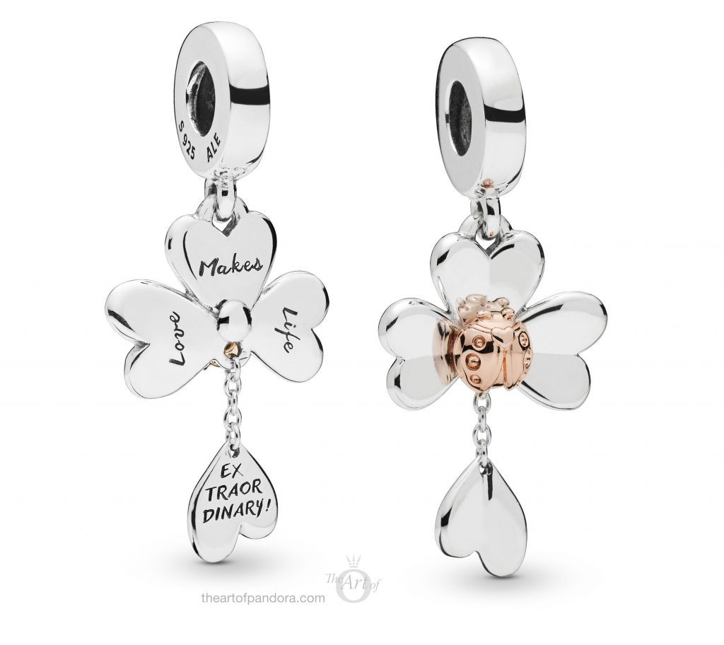 25b3e2673 A PANDORA Rose ladybird and a PANDORA Shine clover hang either side of a  silver horseshoe. All three symbols of Spring hang from a silver bale which  ...