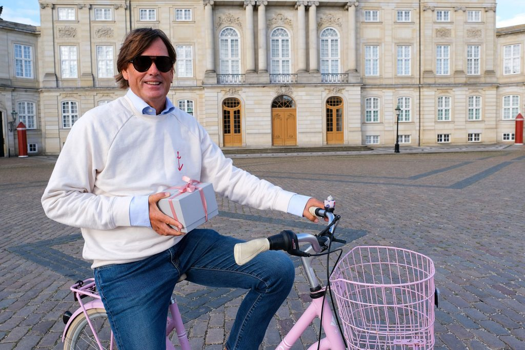 Pandora's Senior Vice President of Global Product Stephen Fairchild delivered a unique gift from Pandora to the Royal Palace for Queen Margrethe II of Denmark on a Pandora pink bicycle!